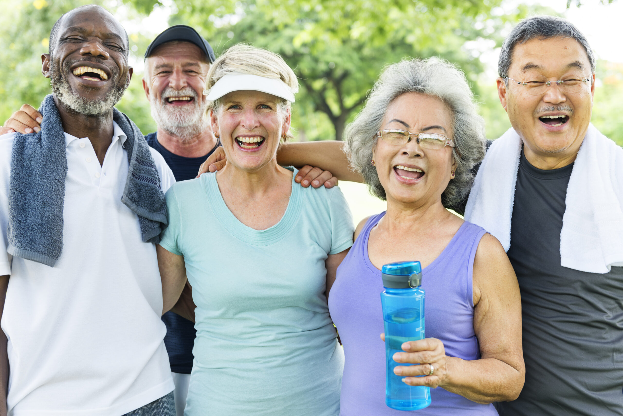 The photo shows a group of five seniors in exercise clothes who look happy.